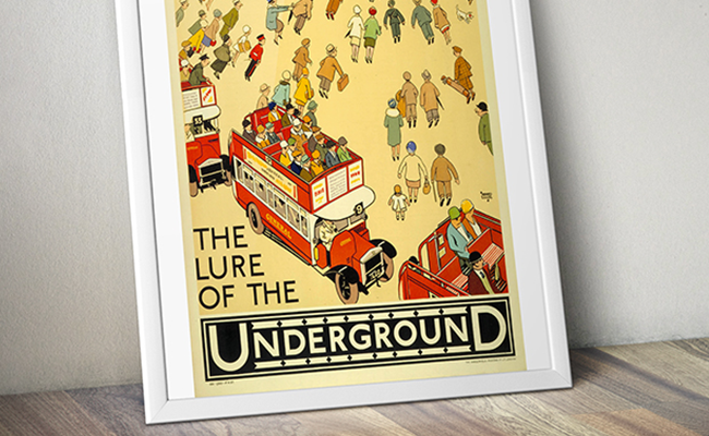 Poster in a white frame with people on a vintage London bus